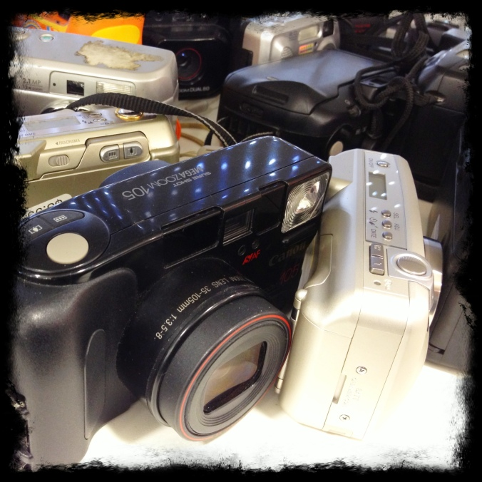 Camera graveyard. Wish I'd come across an old Kodak Disc camera. Anyone have one of those? Atrocious color.